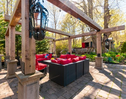 Sandwich Cape Cod vacation rental - Patio with lighted Pergola and comfortable seating