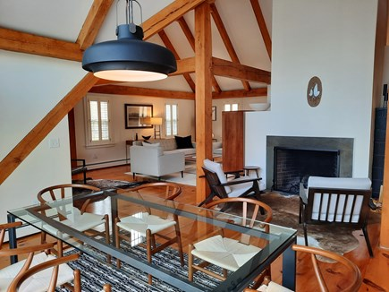 West Barnstable Cape Cod vacation rental - Dining room looking over a fireplace and open concept living room
