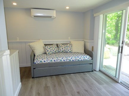 Brewster Cape Cod vacation rental - Lower level offers full bath and slider to side yard