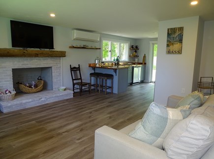 Brewster Cape Cod vacation rental - Living room with hardwood floors, TV, enters into kitchen