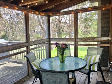 West Harwich Cape Cod vacation rental - Screened porch and back deck with grill.