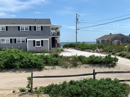 Dennis Cape Cod vacation rental - Across the street from the beach. Water views from front deck.