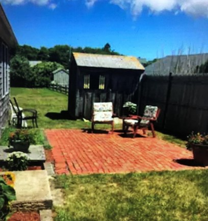 Barnstable, Centerville Cape Cod vacation rental - Port Apt private patio area includes a dining set & grill.