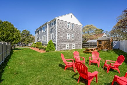 Dennis Port Cape Cod vacation rental - Parking lot & outdoor shower on far side of building (by street)