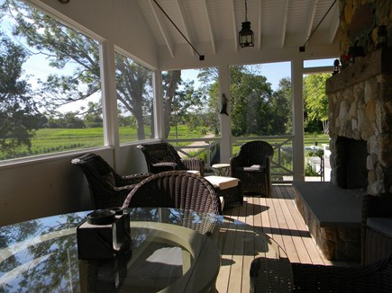 Barnstable, Historic Rte 6A Cape Cod vacation rental - Screen porch with wood-burning stone fireplace and comfy seating