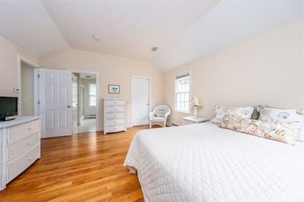 Yarmouth Port Cape Cod vacation rental - Second floor master suite with a queen bed, love seat, and table