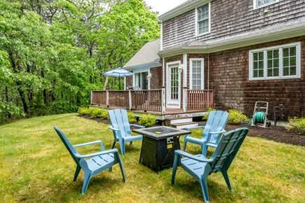 Yarmouth Port Cape Cod vacation rental - Backyard oasis offers privacy, a deck, and propane firepit