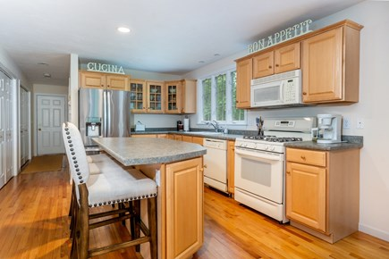 Yarmouth Port Cape Cod vacation rental - Fully equipped kitchen that flows into the dining room
