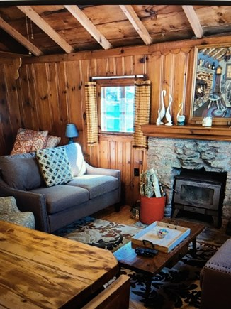 Dennisport Cape Cod vacation rental - Living area with fireplace.