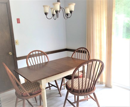 Barnstable, Osterville Cape Cod vacation rental - Eat-in kitchen area - looks out on back yard and patio.