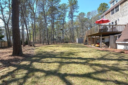 Centerville Cape Cod vacation rental - Large and level backyard to play tag and other cherished games