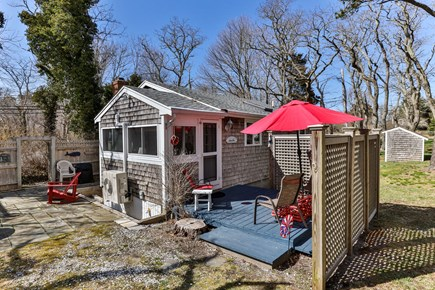 Orleans, Nauset Village Cape Cod vacation rental - Sun & flip flops! Patio & Deck with seating, firepit & grill!