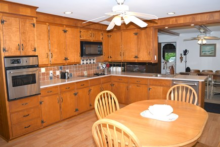 Falmouth, Bay Shore Cape Cod vacation rental - Spacious eat-in kitchen with a door out to the backyard patio.