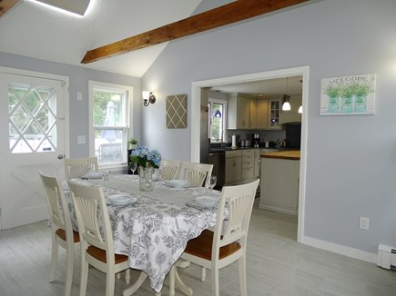 South Yarmouth Cape Cod vacation rental - View of dining room, kitchen and door to deck