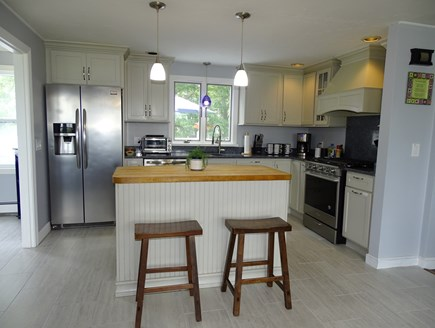 South Yarmouth Cape Cod vacation rental - Modern kitchen with breakfast bar, opens to dining room