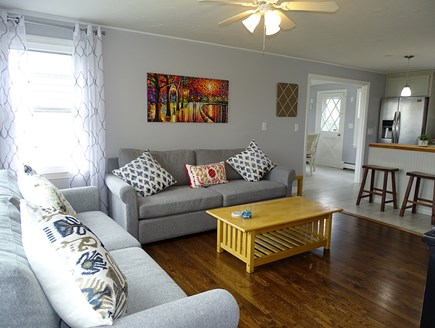 South Yarmouth Cape Cod vacation rental - Living area with new couches, opens to kitchen