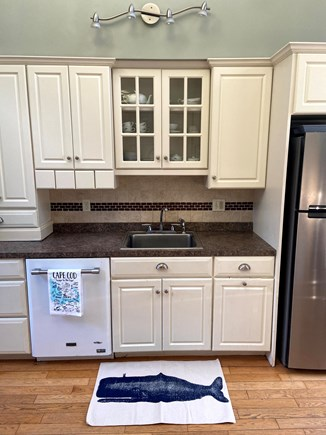 West Falmouth Cape Cod vacation rental - Kitchen sink, fridge, and dishwasher.