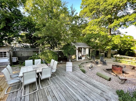 Hyannis Cape Cod vacation rental - Outdoor seating area, firepit and she-shed with full bed inside