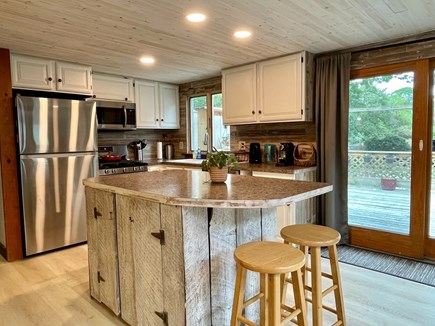 Hyannis Cape Cod vacation rental - Kitchen and sliding door to the backyard