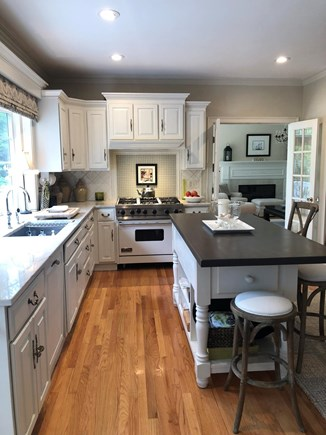 Osterville Cape Cod vacation rental - Fully equipped kitchen looking out to the large deck and yard