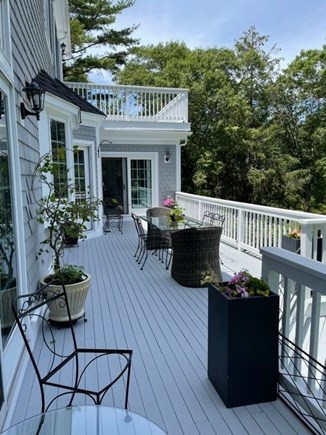 Osterville Cape Cod vacation rental - Large deck with ample seating overlooking back yard and pond