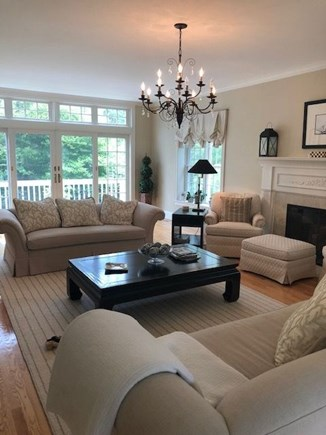 Osterville Cape Cod vacation rental - Front to back livingroom with fireplace and slider to deck