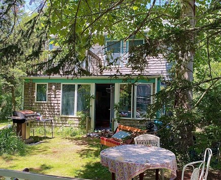 Provincetown Cape Cod vacation rental - View toward the rental, with grill and varied seating.