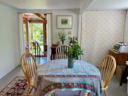 Provincetown Cape Cod vacation rental - Dining area facing out to yard and sunroom.