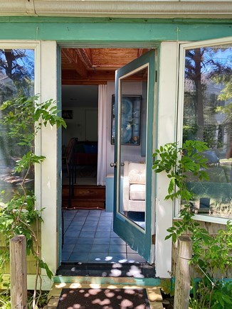 Provincetown Cape Cod vacation rental - Entry into airy sunroom, steps to main room.