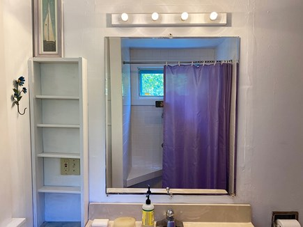 Provincetown Cape Cod vacation rental - Bathroom, tiled shower seat visible in mirror.