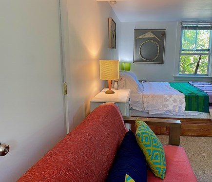 Provincetown Cape Cod vacation rental - Sofa and queen bed. Optional window AC can go by the bed.
