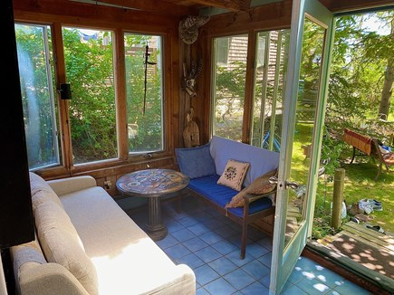 Provincetown Cape Cod vacation rental - Sunroom with seating and handtiled table, screened windows.