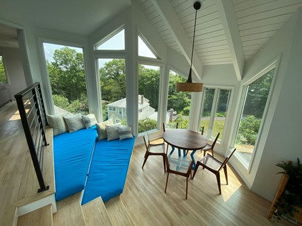 Woods Hole Cape Cod vacation rental - Breakfast nook, surrounded by windows, with two window seats.
