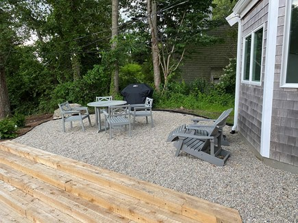 Woods Hole Cape Cod vacation rental - Outdoor patio, with propane grill, seating for 4 and Adirondacks.