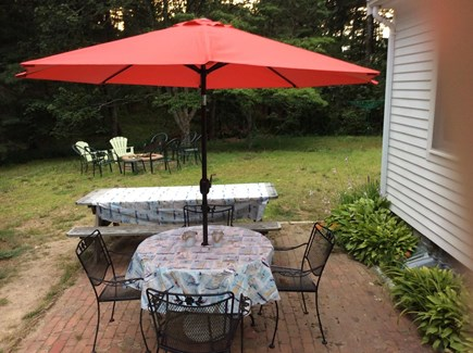 South Dennis Cape Cod vacation rental - Patio table, chairs, picnic table and fire pit with chairs