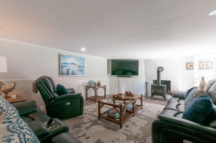West Barnstable Cape Cod vacation rental - Lower level Living area with TV and walkout to patio