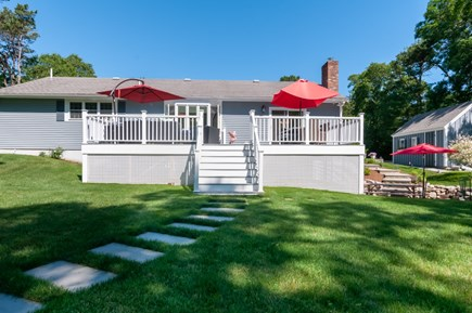 West Barnstable Cape Cod vacation rental - Back of house showing deck on lower patio.