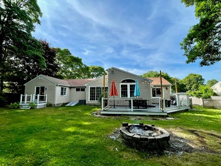 Barnstable, Centerville Cape Cod vacation rental - Backyard with fire pit and patio