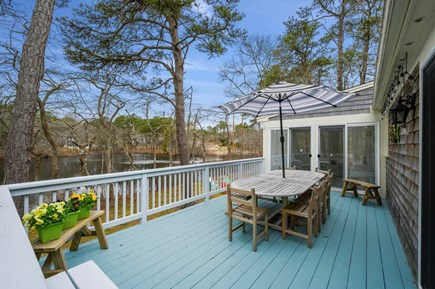 Brewster Cape Cod vacation rental - Back deck with water views. Perfect for taking in the sunset.
