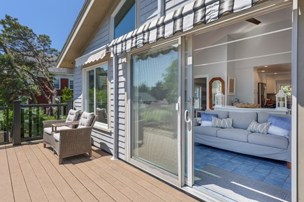 West Dennis Cape Cod vacation rental - Second Floor Deck with seating and stairs down to patio