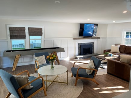 East Dennis Cape Cod vacation rental - Living room with 65 inch TV, gas fireplace, leather couch