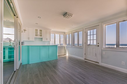 East Sandwich Cape Cod vacation rental - Enclosed Porch with built in bar opens to water side deck