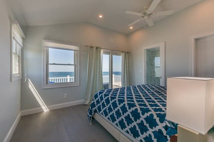 East Sandwich Cape Cod vacation rental - Master Bedroom with ocean views and slider to Upper Level Deck