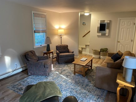 Eastham Cape Cod vacation rental - Well lit living room with comfy sofa-bed and chairs.