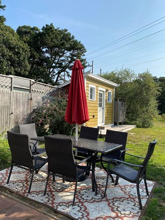 Eastham Cape Cod vacation rental - Outdoor table, storage shed, grill and outdoor shower!