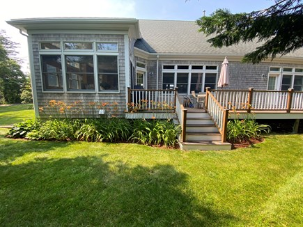 Chatham Cape Cod vacation rental - Back patio with table, outdoor furniture, beach chairs, and grill
