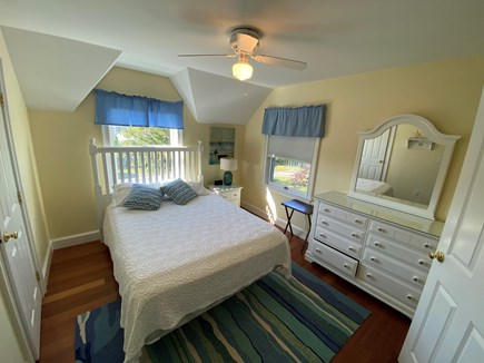 Chatham Cape Cod vacation rental - Queen bed sharing attached to a hallway bathroom with pocket door