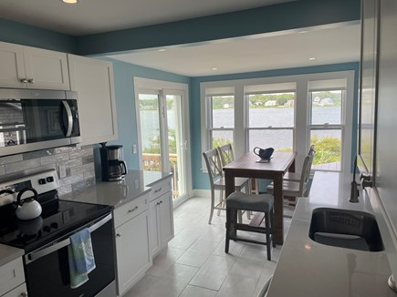 Falmouth Cape Cod vacation rental - Kitchen with slider to deck