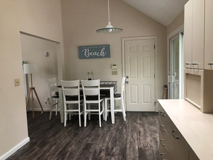 Centerville Cape Cod vacation rental - Eat-in Kitchen with slider out to the deck.