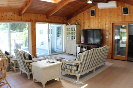 Brewster Cape Cod vacation rental - The sun room with the TV lounge will have strong appeal as well.